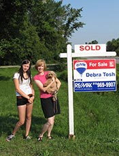 Blaze helps Anne and Robin put up the Sold Sign!
