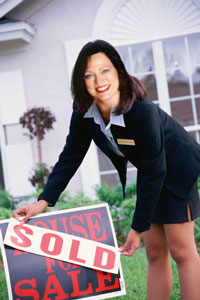 Debra with 'House Sold' sign